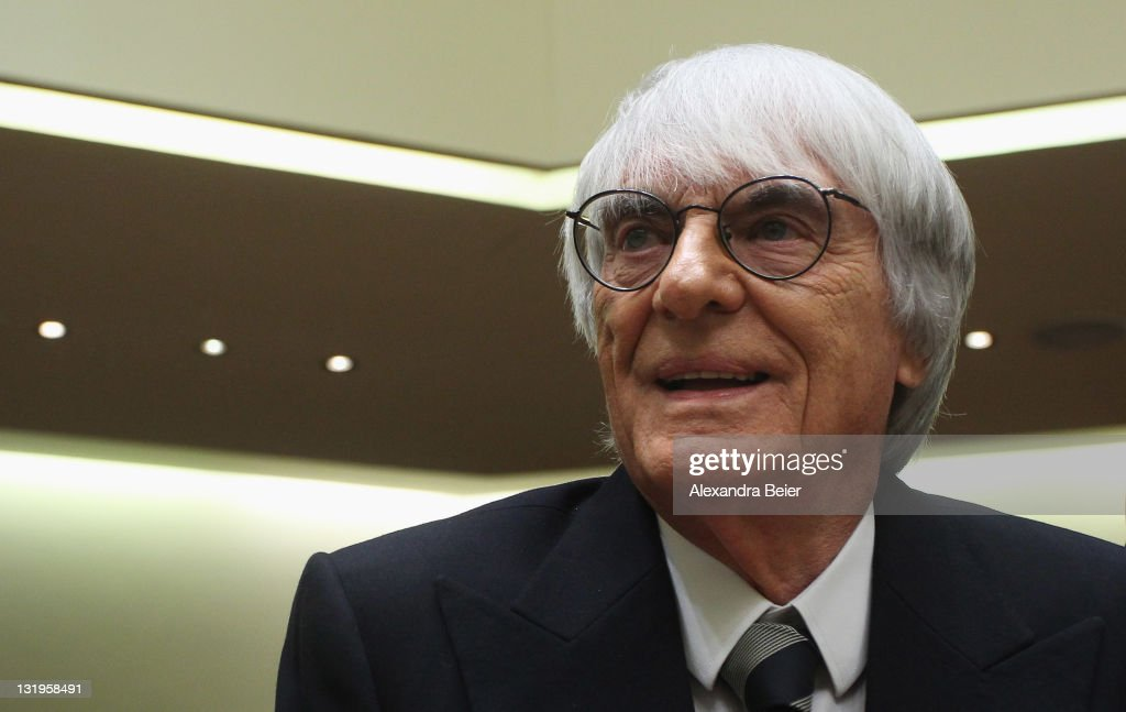 Formula One supremo <a gi-track='captionPersonalityLinkClicked' href=/galleries/search?phrase=Bernie+Ecclestone&family=editorial&specificpeople=211579 ng-click='$event.stopPropagation()'>Bernie Ecclestone</a> smiles as he arrives as witness for the trial against former CEO of Bayerische Landesbank and Formula One chairman Gerhard Gribkowsky on November 9, 2011 in Munich, Germany. Former banker Gribkowsky is accused of having received a $44 million (33.06 million euros) bribe in connection with the sale of F1 to CVC for $1.7 billion (1.28 bilion euros) billion in 2006.