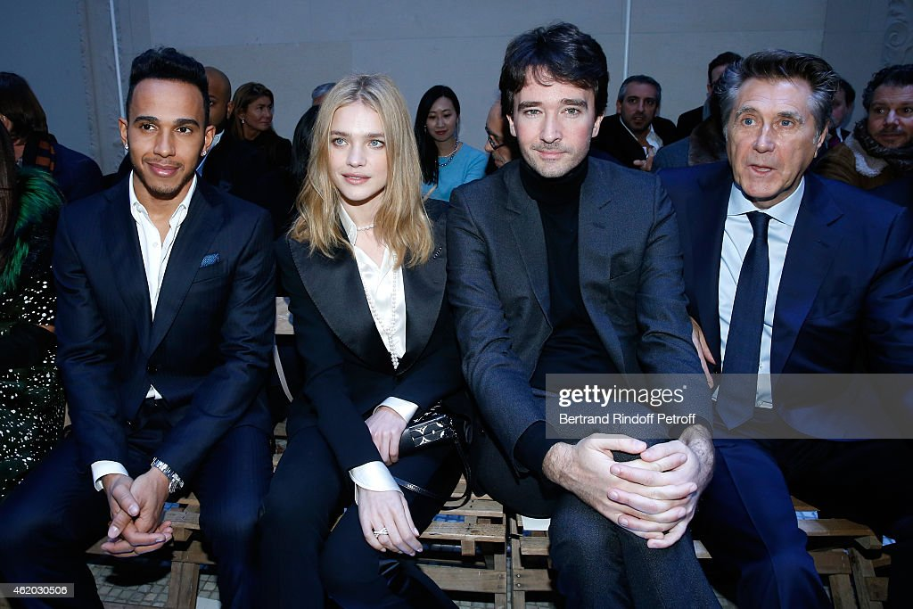 Formula One World Champion Lewis Hamilton, Model Natalia Vodianova, General manager of Berluti Antoine Arnault and singer Bryan Ferry attend the Berluti Menswear Fall/Winter 2015-2016 Show as part of Paris Fashion Week. Held at Musee des Arts Decoratifs on January 23, 2015 in Paris, France.