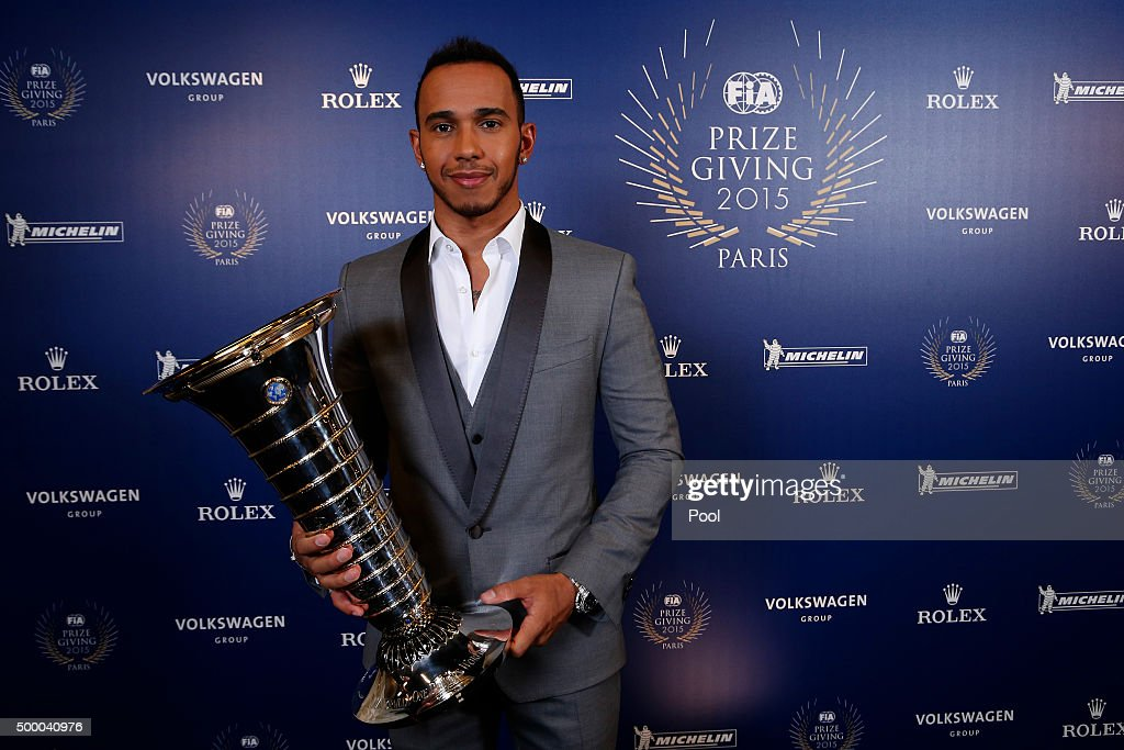 Formula One World Champion Lewis Hamilton of Great Britain and Mercedes GP poses with the Drivers' Championship trophy during the 2015 FIA Prize-Giving Ceremony at the Lido Theatre on December 4, 2015 in Paris, France.