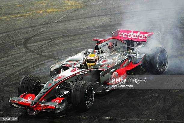 Formula One World Champion Lewis Hamilton of Great Britain and McLaren Mercedes performs donuts for the crowd in a demonstration run of his...