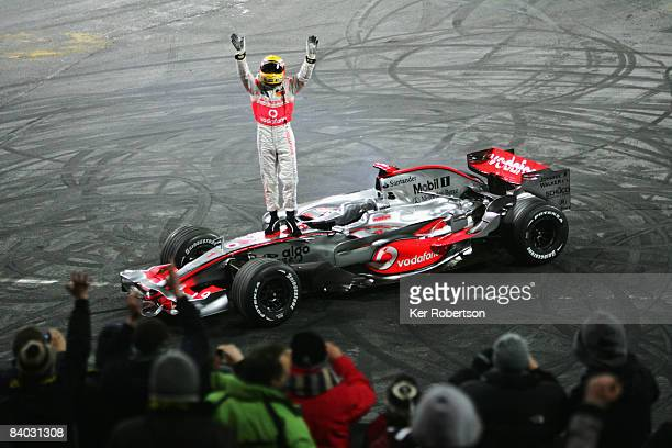 Formula One World Champion Lewis Hamilton of Great Britain and McLaren Mercedes acknowledges the crowd following a demonstration run in his...