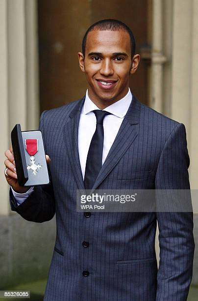 Formula One world champion Lewis Hamilton with the MBE he received from Queen Elizabeth II at Buckingham Palace on March 10 2009 in London England