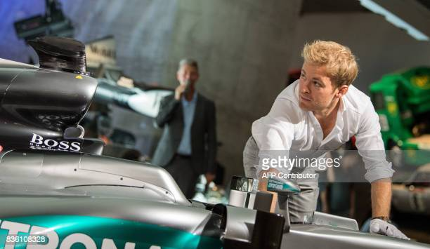 Formula One World champion Nico Rosberg pushes his car during the transfer of his world championship car a Mercedes F1 W07 hybrid into the...