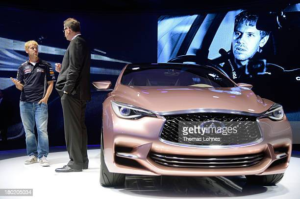 Formula One World Champion Sebastian Vettel and the president of Infiniti Motor Company LTD Johann de Nysschen present the new Q30 concept at the IAA...