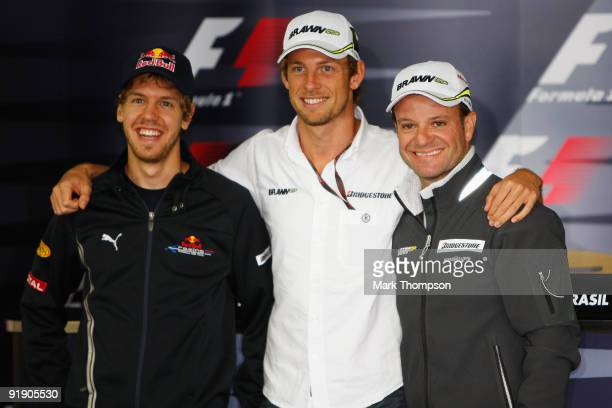Formula One World Championship rivals Sebastian Vettel of Germany and Red Bull Racing Jenson Button of Great Britain and Brawn GP and Rubens...