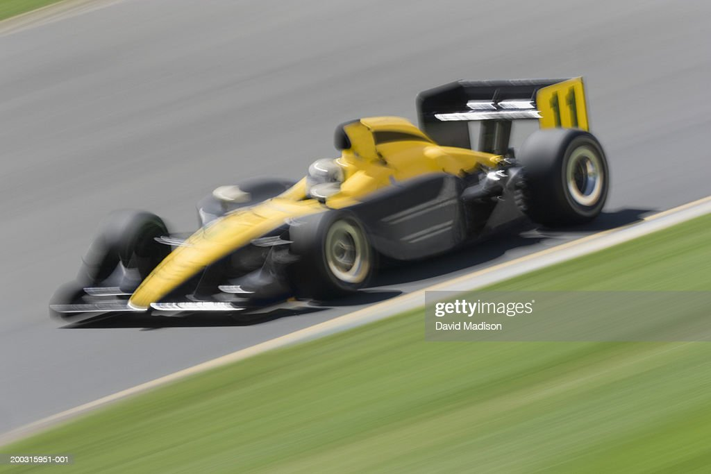 Formula race car racing on track (blurred motion) : Stock Photo