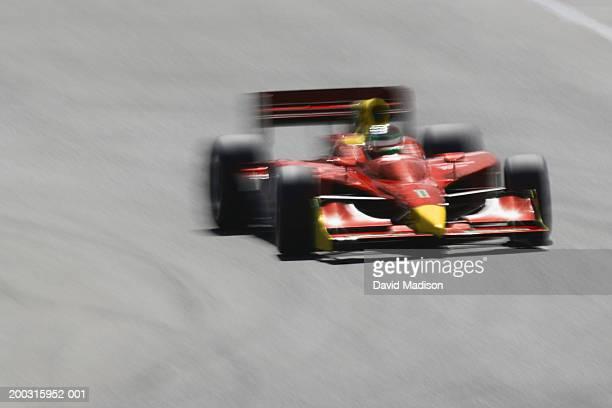 Formula race car racing on track (blurred motion)