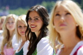 Formula Unas wait for the start of the drivers' parade during the Austrian Formula One Grand Prix at Red Bull Ring on June 22 2014 in Spielberg...