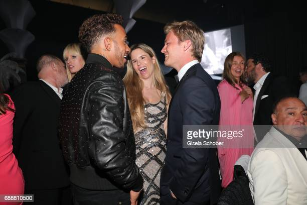 Formula1 driver Lewis Hamilton Nico Rosberg and his wife Vivian Rosberg attend the amfAR Gala Cannes 2017 at Hotel du CapEdenRoc on May 25 2017 in...
