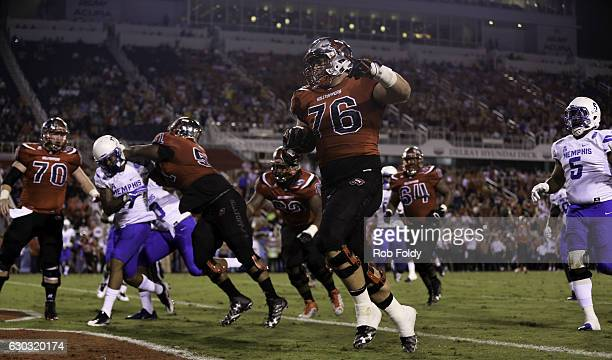 Forrest Lamp of the Western Kentucky Hilltoppers scores a touchdown during the first half of the game against the Memphis Tigers at FAU Stadium on...