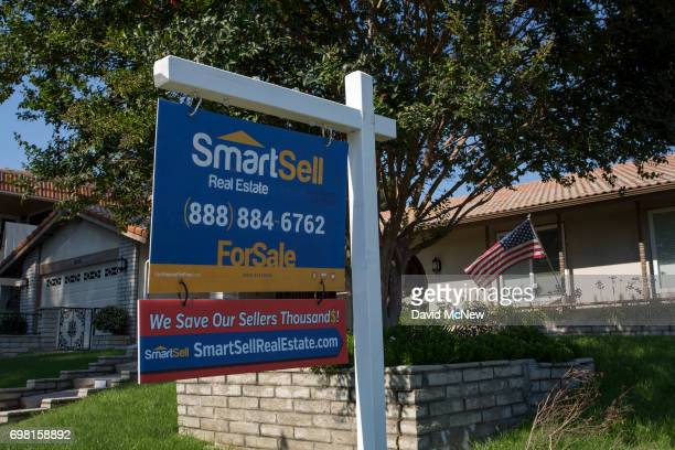 A forsale sign is seen on a home next to the San Andreas Fault on June 18 2017 in Highland California An earthquake early warning system under...