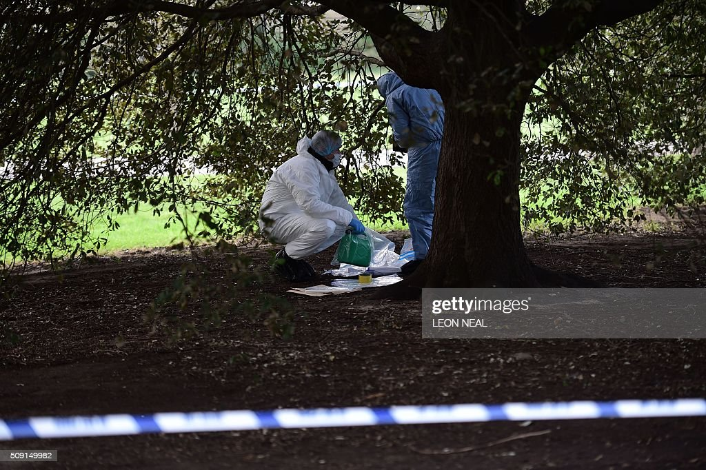 A forsensics officer holds a plastic fuel cannister in an evidence bag under a tree close to the scene where a man died after being discovered on fire in the park outside the wall of Kensington Palace in London on February 9, 2016. A man has died after being found on fire outside Kensington Palace in the early hours of February 9, police said. Officers were called to the London home of the Duke and Duchess of Cambridge after receiving reports a man was behaving suspiciously. On arrival a man was found on fire and despite efforts from officers and paramedics the man was pronouced dead at the scene. NEAL
