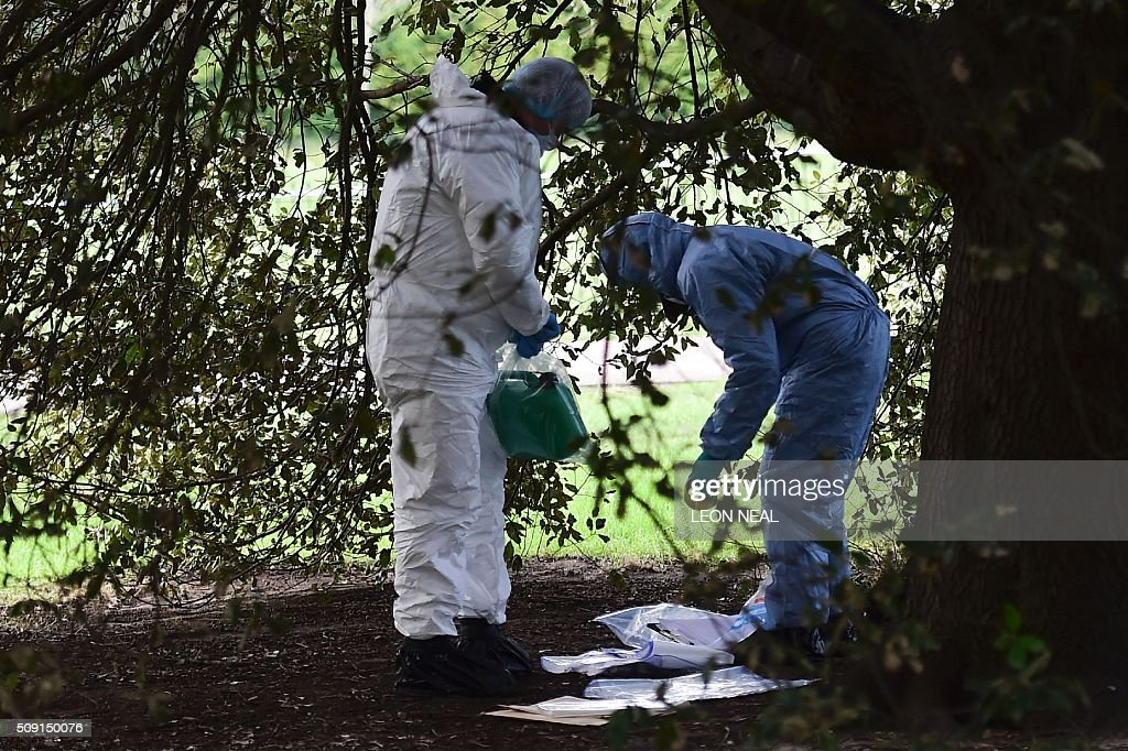 A forsensics officer holds an evidence bag containing a plastic fuel cannister behind a police cordon under a tree close to the scene where a man died after being discovered on fire in the park outside the wall of Kensington Palace in London on February 9, 2016. A man has died after being found on fire outside Kensington Palace in the early hours of February 9, police said. Officers were called to the London home of the Duke and Duchess of Cambridge after receiving reports a man was behaving suspiciously. On arrival a man was found on fire and despite efforts from officers and paramedics the man was pronouced dead at the scene. NEAL