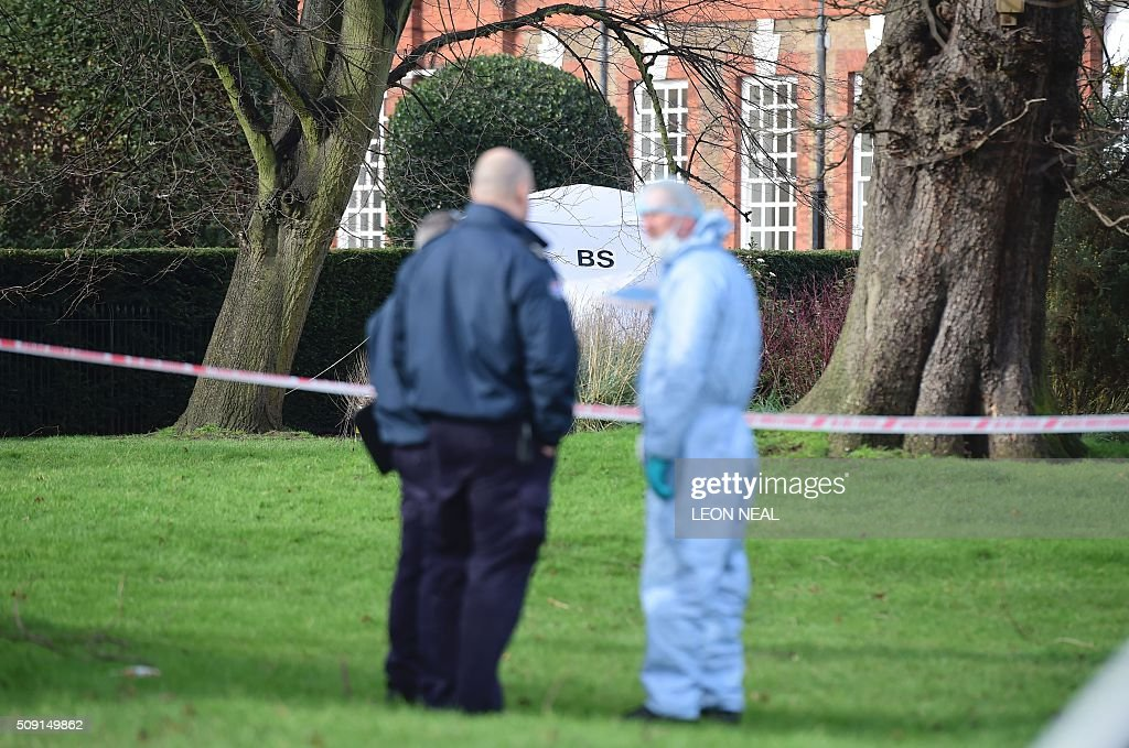 A forsensics officer in overalls stands at in front of the tent errected over the scene where a man died after being discovered on fire in the park outside the wall of Kensington Palace in London on February 9, 2016. A man has died after being found on fire outside Kensington Palace in the early hours of February 9, police said. Officers were called to the London home of the Duke and Duchess of Cambridge after receiving reports a man was behaving suspiciously. On arrival a man was found on fire and despite efforts from officers and paramedics the man was pronouced dead at the scene. NEAL