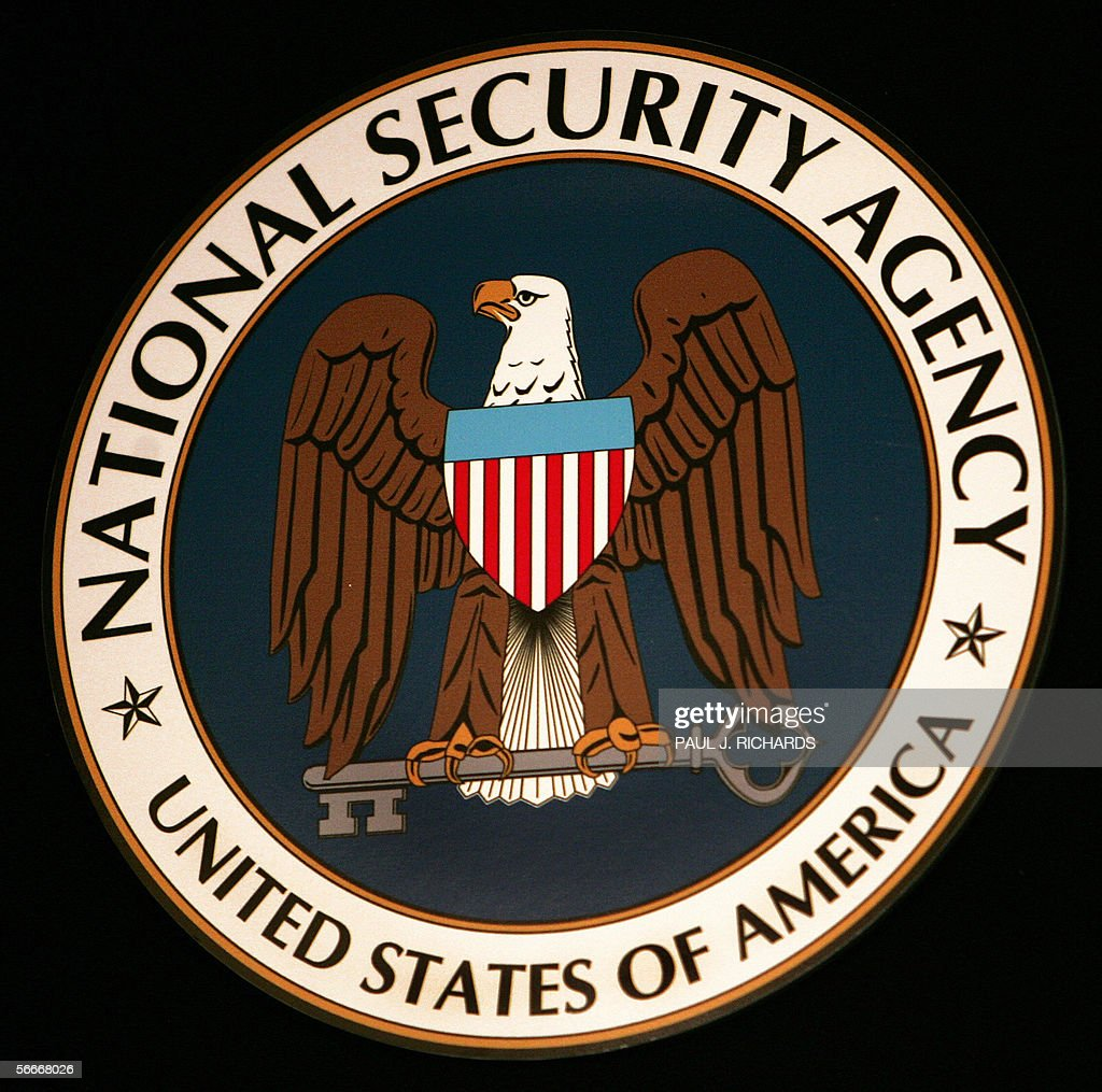 The logo of the National Security Agency (NSA) hangs at the Threat Operations Center inside the NSA in the Washington suburb of Fort Meade, Maryland, 25 January 2006. US President George W. Bush delivered a speech behind closed doors and met with employees in advance of Senate hearings on the much-criticized domestic surveillance. AFP PHOTO/Paul J. RICHARDS