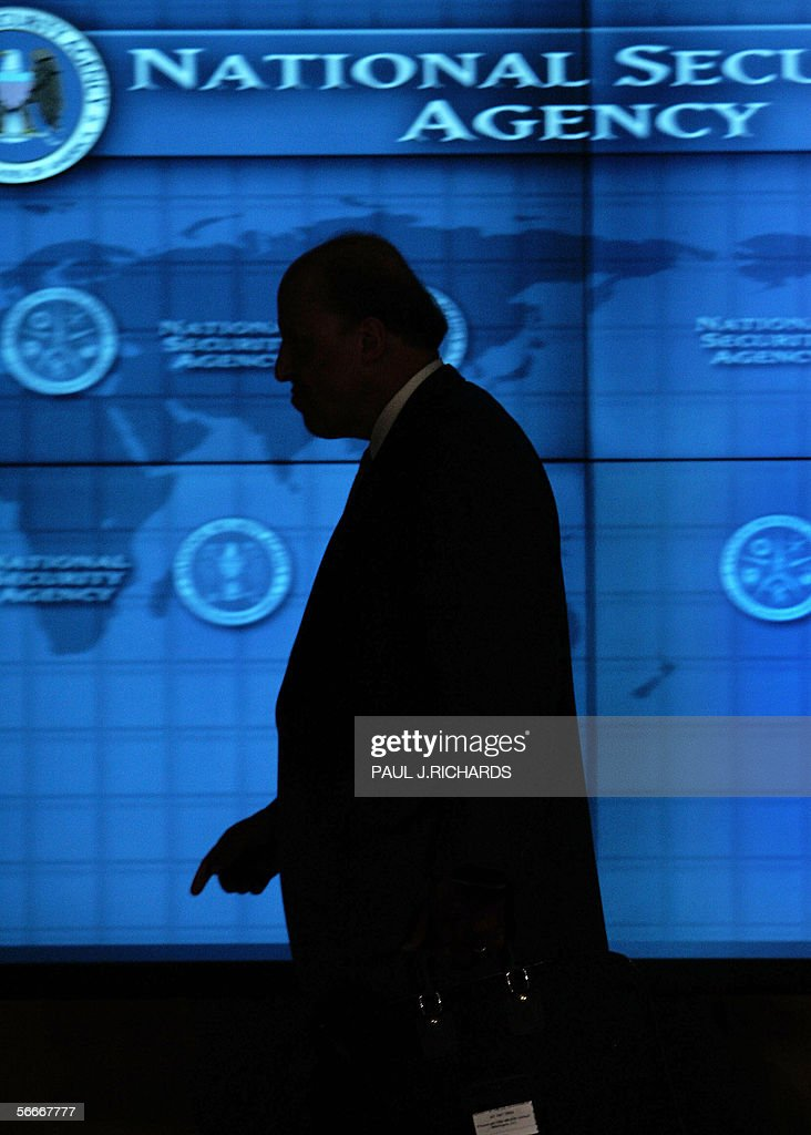 US Director of National Intelligence, John Negroponte walks in the hallways of the Threat Operations Center inside the National Security Agency (NSA) 25 January 2006 in suburban Fort Mead, Maryland, after US President George W. Bush met with employees and delivered an address in advance of US Senate hearings on the administration's much-criticized domestic surveillance. AFP Photo/Paul J. RICHARDS