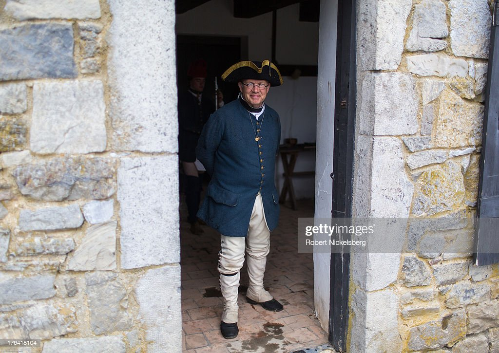 A Fort Ticonderoga tour guide dressed as a French soldier August 1, 2013 wears a uniform from 1755 in Ticonderoga, New York. The large 18th-century fort was built and completed by the French in 1757 at the south end of Lake Champlain during the French and Indian War. The fort was of strategic importance during the 18th-century colonial conflicts between Great Britain and France in the settling of North America and played a role during the American Revolutionary War.