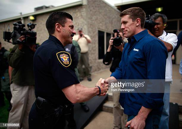 Fort Worth Police Chief Jeffrey W Halstead welcomes NASCAR driver Carl Edwards during a training event with members of the Fort Worth police...