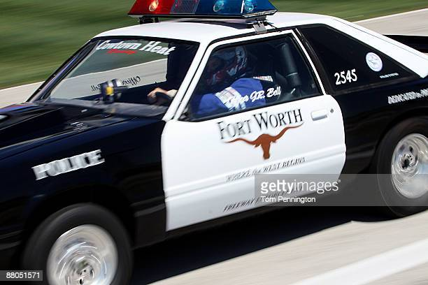Fort Worth police officer JR Bell drag races down pit lane at Texas Motor Speedway to kickoff the new Scion DragnBrag organized street racing series...