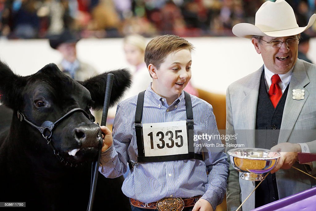 Fort Worth Stock Show President and General Manager Brad Barnes, right, presents Jagger Horn with the Grand Championship Steer trophy at the Fort Worth Stock Show and Rodeo on Friday, Feb. 5, 2016, in Fort Worth, Texas.