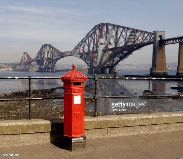 Forth Bridge with a red post box in foreground The Forth Bridge is a railway bridge over the Firth of Forth in the east of Scotland to the east of...