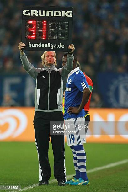 Forth referee Bibiana Steinhaus holds the substitute board during the Bundesliga match between FC Schalke 04 and Bayer 04 Leverkusen at Veltins Arena...