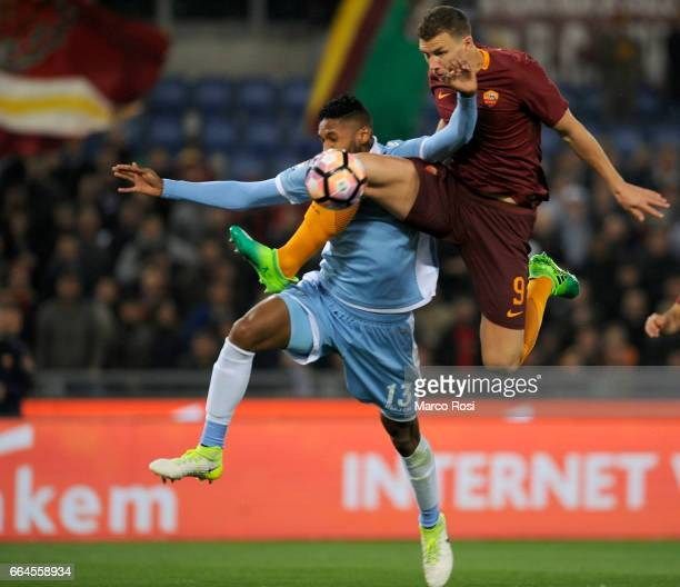Fortuna Wallace of SS Lazio battles with Edin Dzeko of AS Roma during the TIM Cup match between AS Roma and SS Lazio at Stadio Olimpico on April 4...