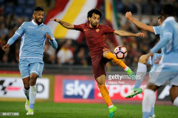 Fortuna Wallace of SS Lazio battles with Mohamed Salah of AS Roma during the TIM Cup match between AS Roma and SS Lazio at Stadio Olimpico on April 4...