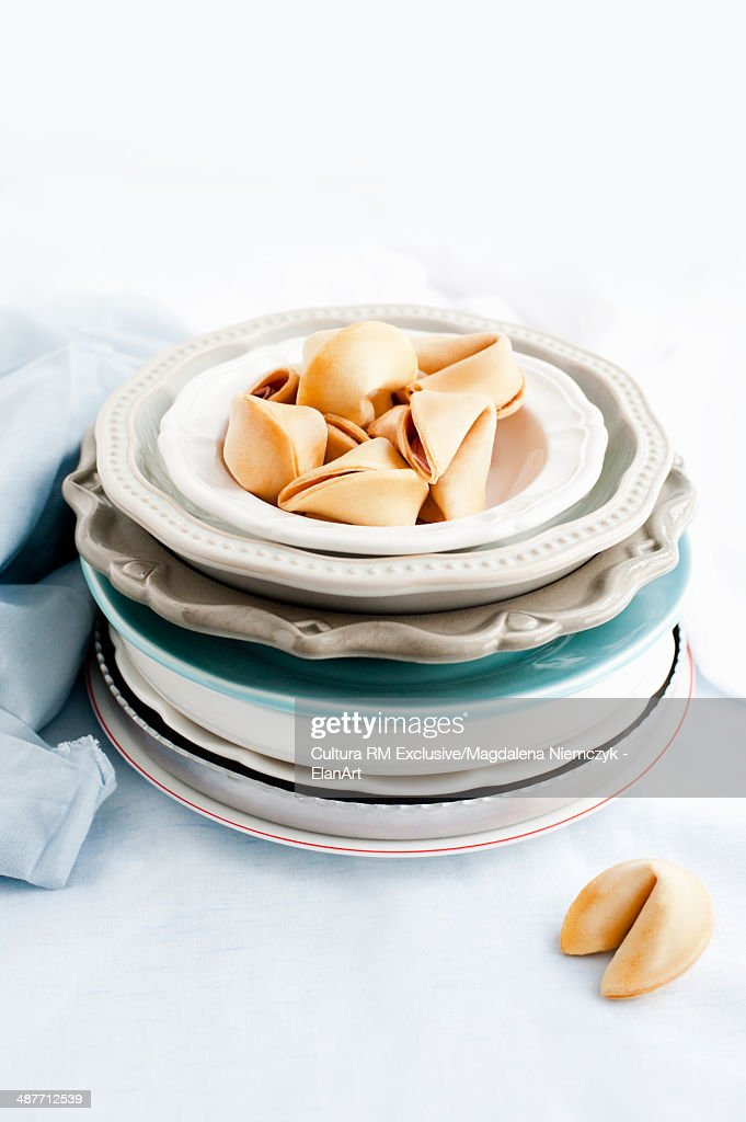 Fortune cookies on stack of plates : Stock Photo