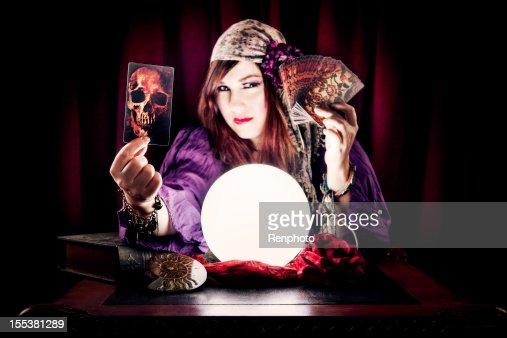 Fortune Teller Holding Skull Tarot Card