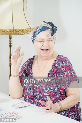 Fortune teller smoking : Stock Photo