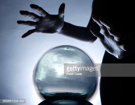 Fortune teller with  crystal ball, close-up : Bildbanksbilder