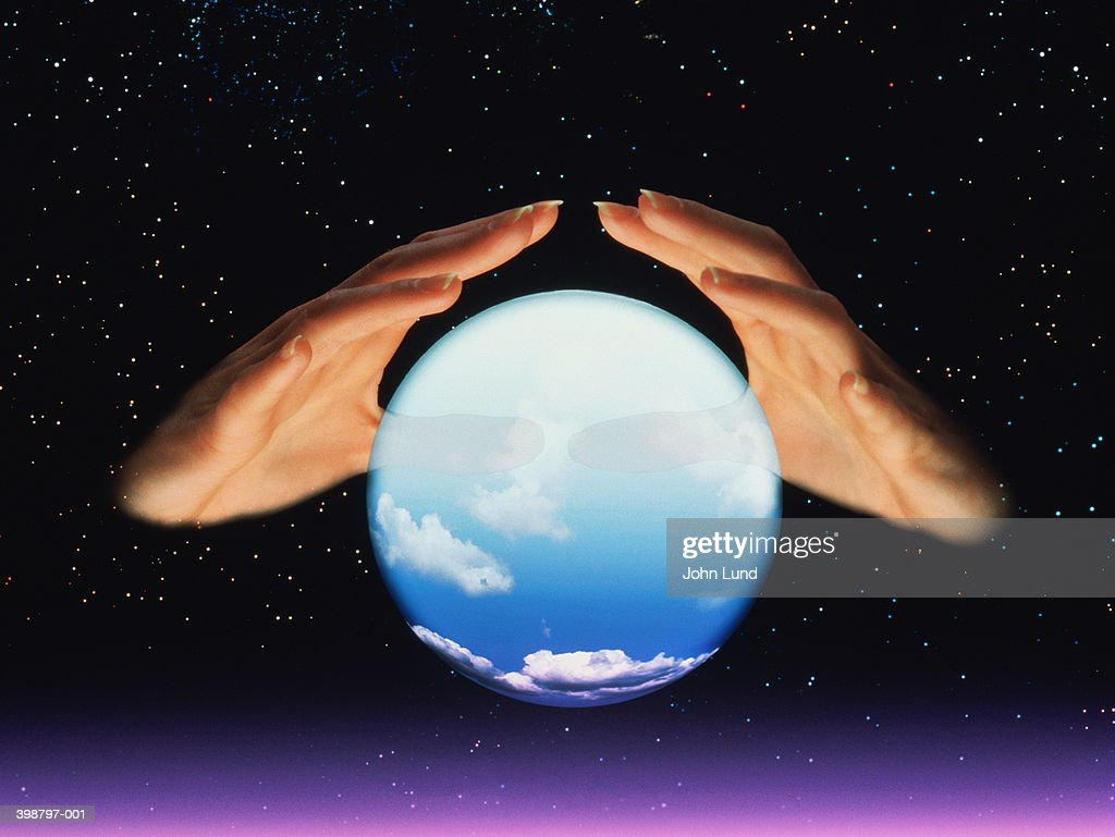 Fortune tellers hands and crystal ball : Stock Photo