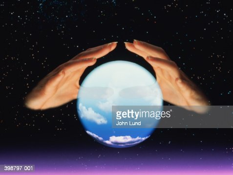 Fortune tellers hands and crystal ball : Photo