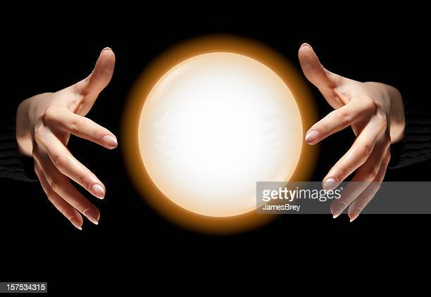 Fortune Teller's Hands With Glowing Crystal Ball, Dark Black Background