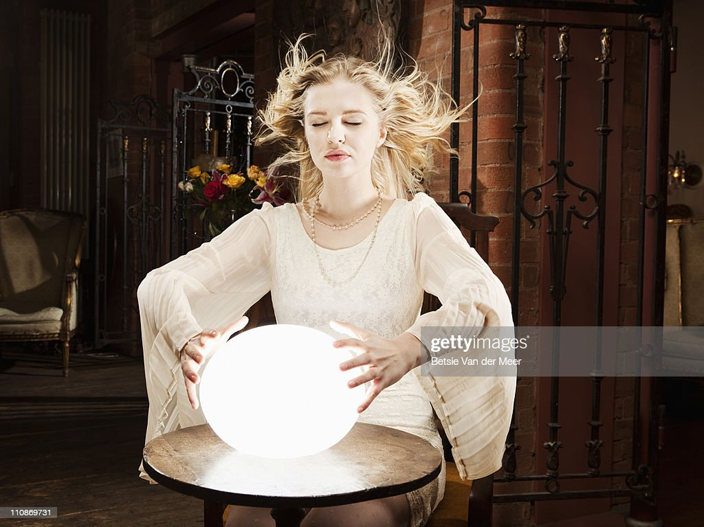 Fortuneteller tells  future in crystal ball : Stock Photo