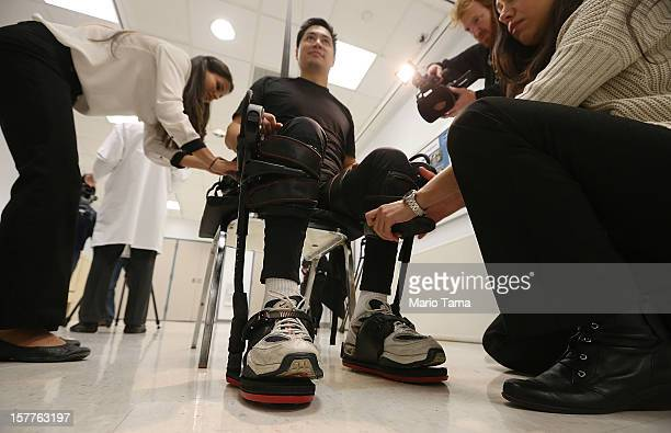 Forty threeyearold parapalegic Robert Woo is outfitted with an exoskeleton device to walk in made by Ekso Bionics as Manuel Maldonado during a...