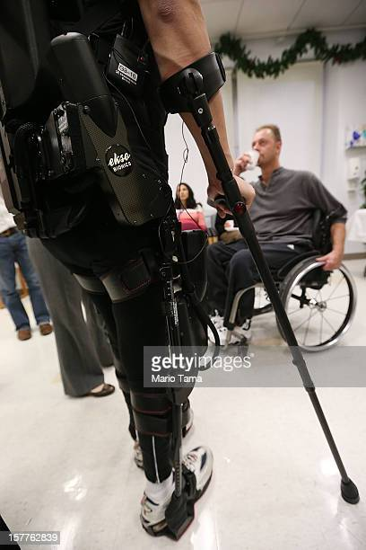 Forty threeyearold parapalegic Robert Woo stands while walking with an exoskeleton device made by Ekso Bionics during a demonstration at the opening...