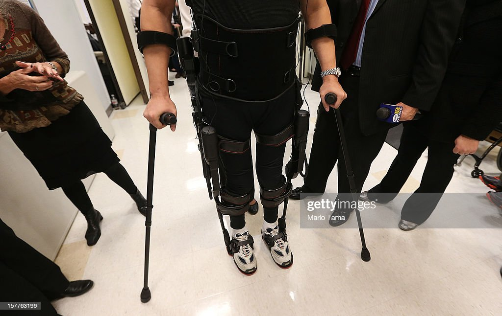 Forty three-year-old parapalegic Robert Woo stands while walking with an exoskeleton device made by Ekso Bionics during a demonstration at the opening of the Rehabilitation Bionics Program at Mount Sinai Rehabilitation Center on December 6, 2012 in New York City. Woo is an architect who was paralyzed from the hips down during a construction accident and thought he would never walk again. The new strap-on exoskelton uses motors and sensors to physically move the legs.