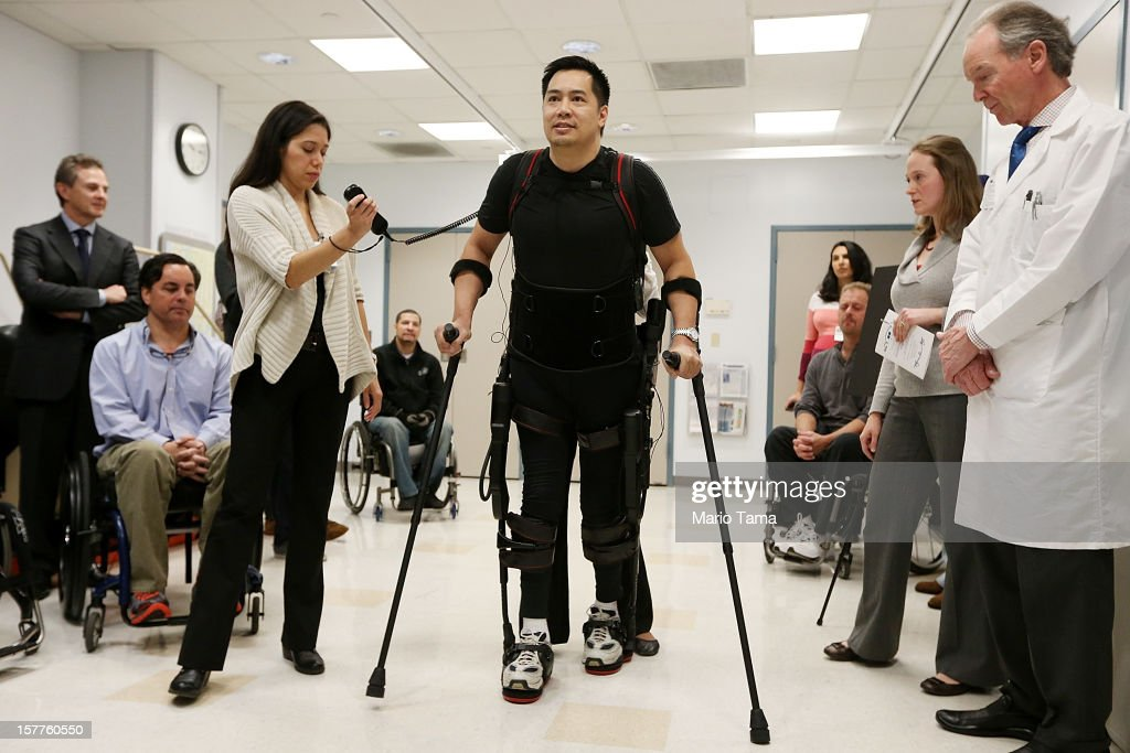 Forty three-year-old parapalegic Robert Woo walks with an exoskeleton device made by Ekso Bionics during a demonstration at the opening of the Rehabilitation Bionics Program at Mount Sinai Rehabilitation Center on December 6, 2012 in New York City. Woo is an architect who was paralyzed from the hips down during a construction accident and thought he would never walk again. The new strap-on exoskelton uses motors and sensors to physically move the legs.