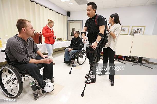 Forty threeyearold parapalegic Robert Woo walks with an exoskeleton device made by Ekso Bionics during a demonstration at the opening of the...