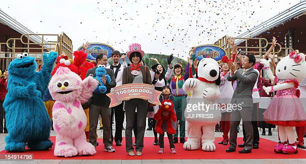 Fortyoneyearold Japanese woman Yumiko Yamashita is cheered by various characters as she is recognised as the 100millionth guest of the Hollywood...