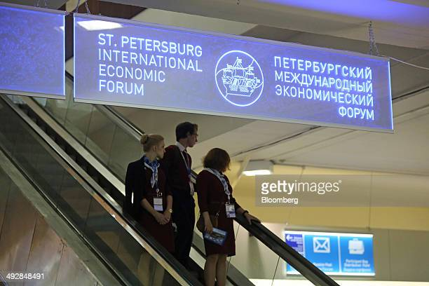 Forum employees arrive at the entrance hall on the opening day of the St Petersburg International Economic Forum in Saint Petersburg Russia on...