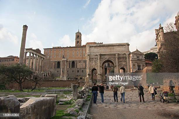 Forum Romanum with Titus arch, columns of the Saturn temple and the Capitol, Rome, Italy