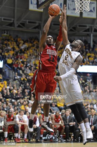 Forward Aaron Adeoye of the Western Kentucky Hilltoppers puts up a shot against forward Chadrack Lufile of the Wichita State Shockers during the...