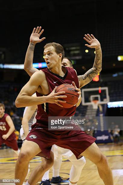 IUPUI forward Aaron Brennan drives with the ball during the NCAA men's basketball game between the IUPUI Jaguars and the Marquette Golden Eagles at...
