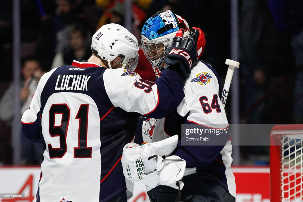 Forward Aaron Luchuk #91 of the Windsor Spitfires celebrates with goaltender Michael DiPietro #64 after his game winning third period goal against the London Knights on October 12, 2017 at the WFCU Centre in Windsor, Ontario, Canada.