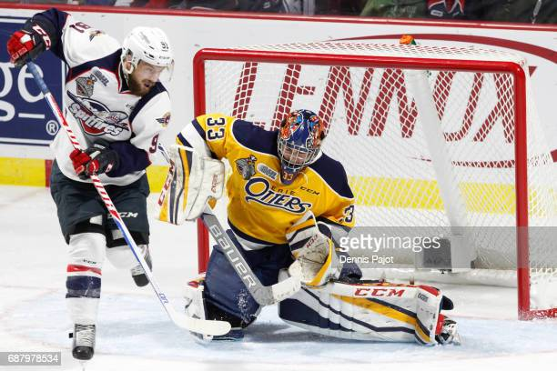 Forward Aaron Luchuk of the Windsor Spitfires deflects the puck against goaltender Troy Timpano of the Erie Otters on May 24 2017 during Game 6 of...