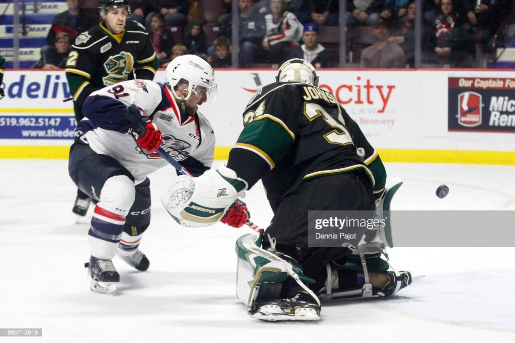 Forward Aaron Luchuk #91 of the Windsor Spitfires fires his second period goal past goaltender Tyler Johnson #34 the London Knights on October 12, 2017 at the WFCU Centre in Windsor, Ontario, Canada.