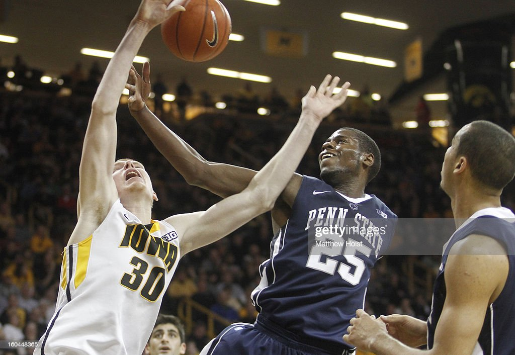 Forward Aaron White #30 of the Iowa Hawkeyes battles for a rebound during the second half against forward Jon Graham #25 of the Penn State Nittany Lions on January 31, 2013 at Carver-Hawkeye Arena in Iowa City, Iowa.
